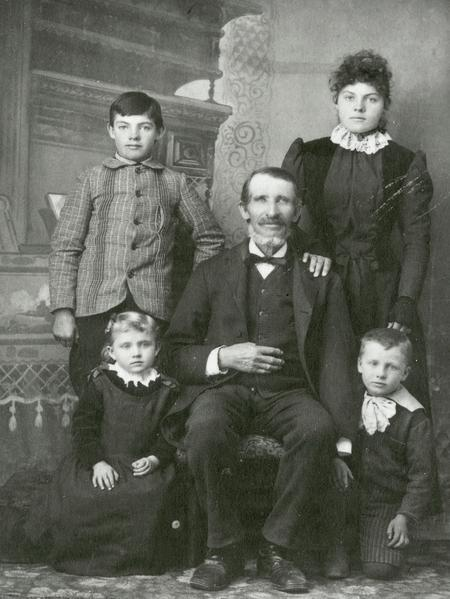 Photograph, photographer unknown, 1893. (Church History Library, Salt Lake City.) This photograph, taken at the 1893 World's Fair in Chicago, shows Coray with grandchildren Eppie and Sidney Coray (seated) and step-grandchildren Laban and Elizabeth Harding.
